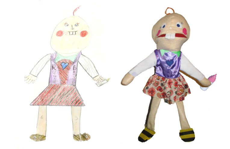 a puppet of a baby made from a child's drawing.