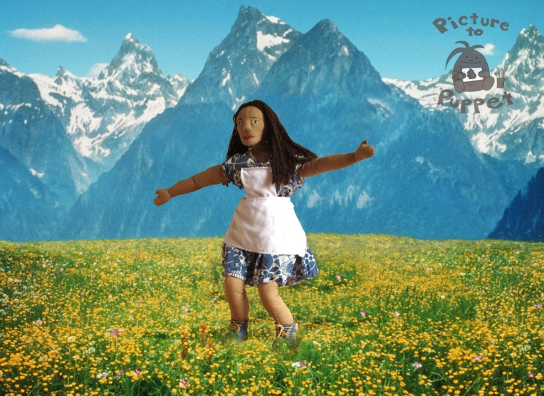 Josie in a wide meadow in a pose echoing Maria in The Sound of Music.