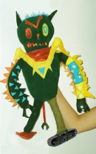 A puppet of an alien made from a child's drawing.